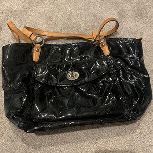 Black shiny with tan straps coach purse